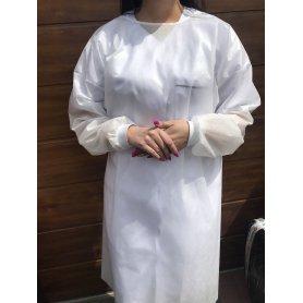 Fartuch jednorazowy włókninowy na troki z gumkami na mankietach - biały